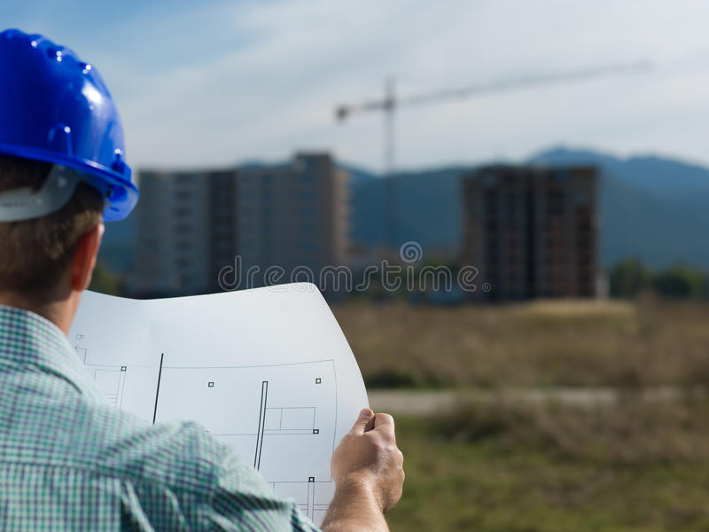 Architect reading technical drawing of construction royalty free stock photos