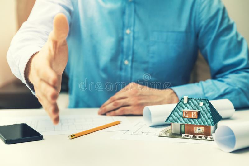 Architect real estate agent offering partnership to customer stock photo