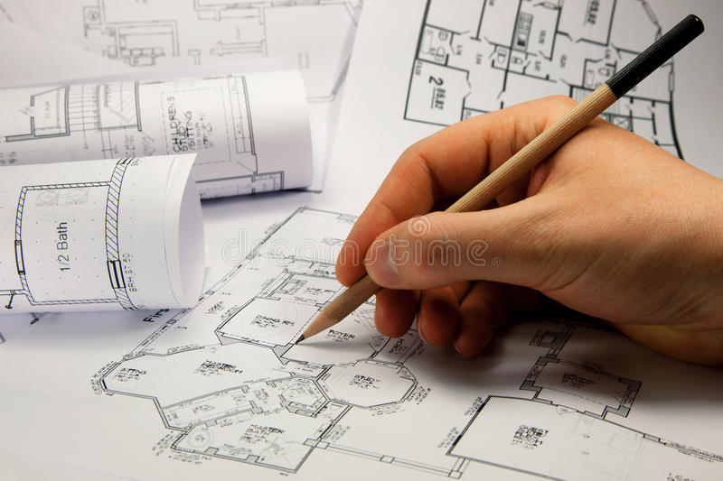 Architect's hand drawing. Architect's hand with pencil drawing plan