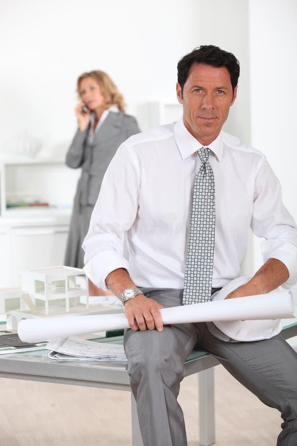 Architect Sat At Desk Stock Image