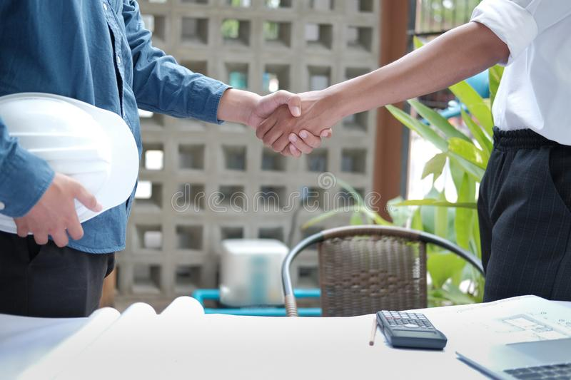Architect shaking hands after meeting. engineer handshaking after conference. teamwork partnership cooperate concept royalty free stock image