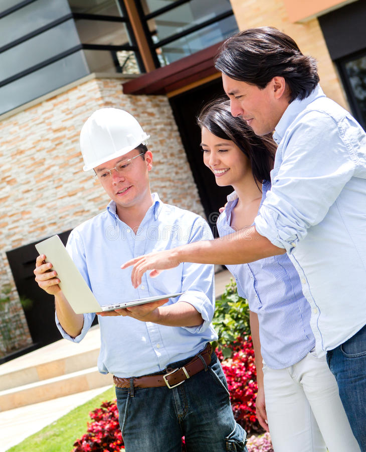Download Architect Showing House To A Couple Stock Photo - Image of outdoors, people: 27023608