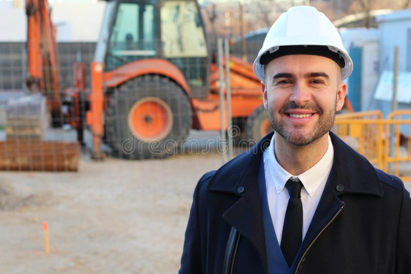 Architect smiling in construction site royalty free stock images