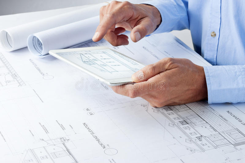 Architect Tablet Business Plans Architecture Desk royalty free stock image