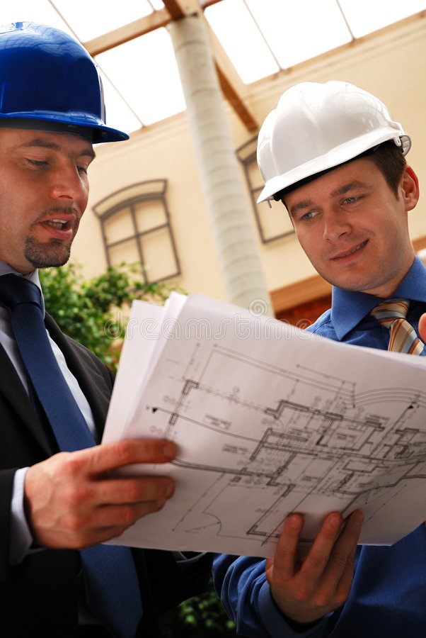 Architect talking to investor over the blueprints royalty free stock photography
