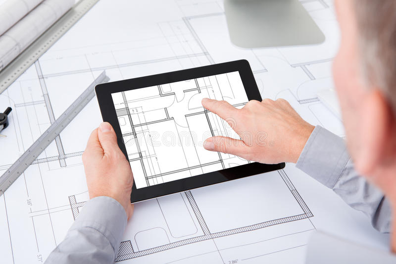 Architect using digital tablet royalty free stock photo