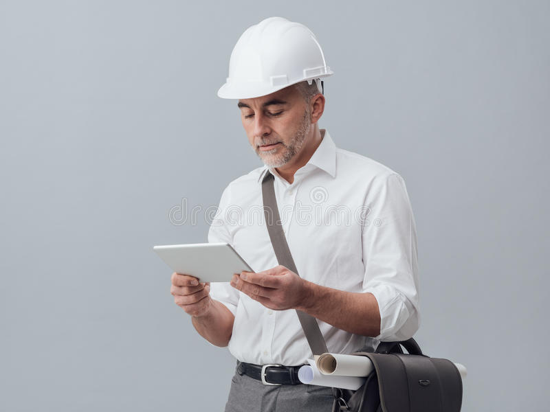 Architect using a digital tablet stock photography