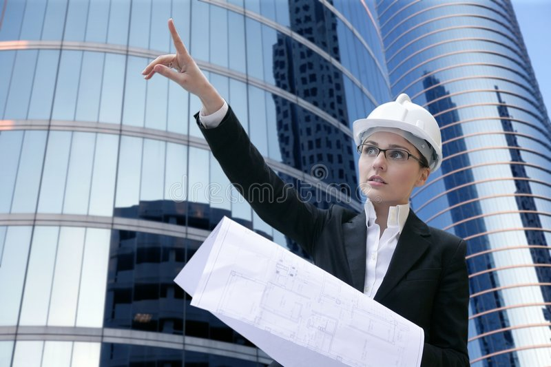 Architect woman working outdoor with buildings stock photos