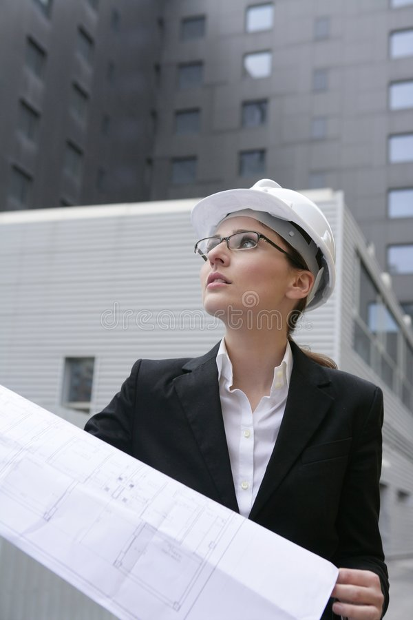 Architect woman working outdoor with buildings stock images