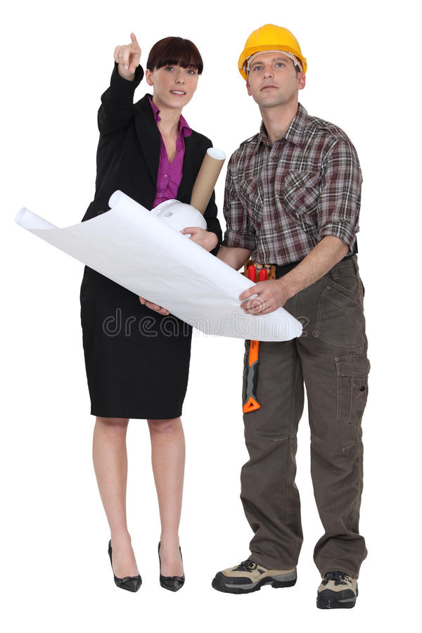 Architect and worker. Looking at plans stock photography