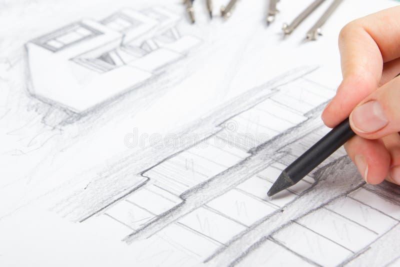 Architect Working On Blueprint stock foto