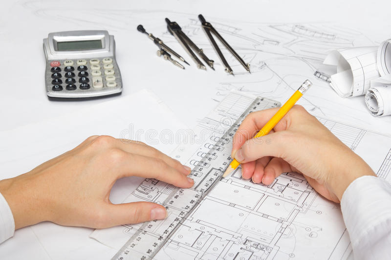 Architect working on blueprint architects workplace architectural download architect working on blueprint architects workplace architectural project blueprints ruler malvernweather Image collections