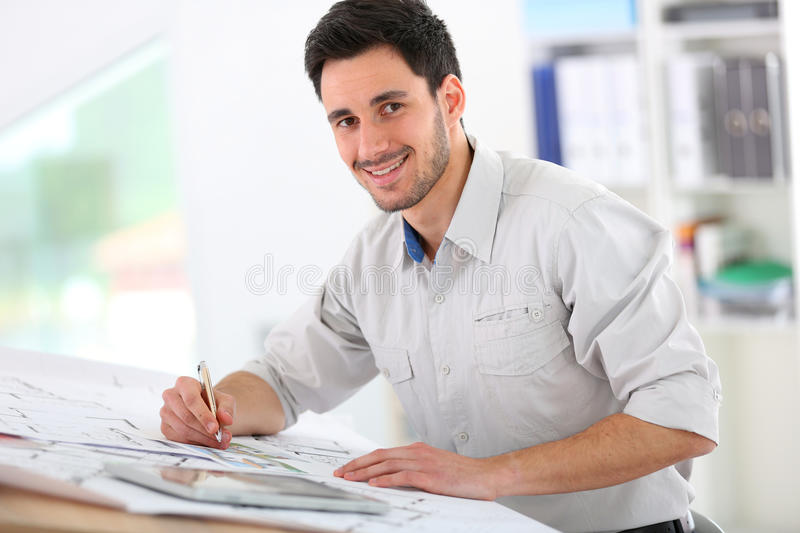 Architect working on blueprint. Architect in office drawing construction blueprint stock photography