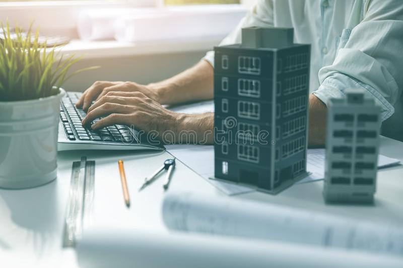 Architect working on computer in office typing on keyboard stock image