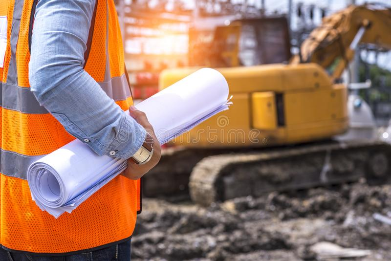 Architect working at construction site royalty free stock photography