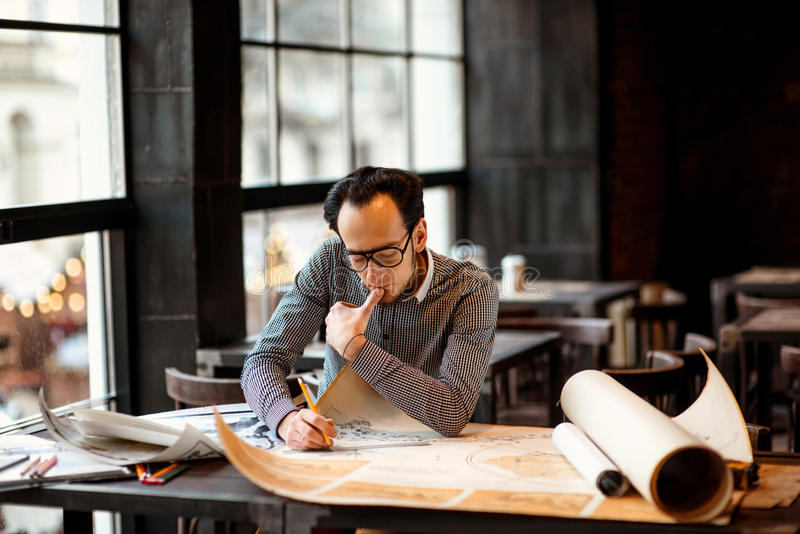 Architect working stock photos