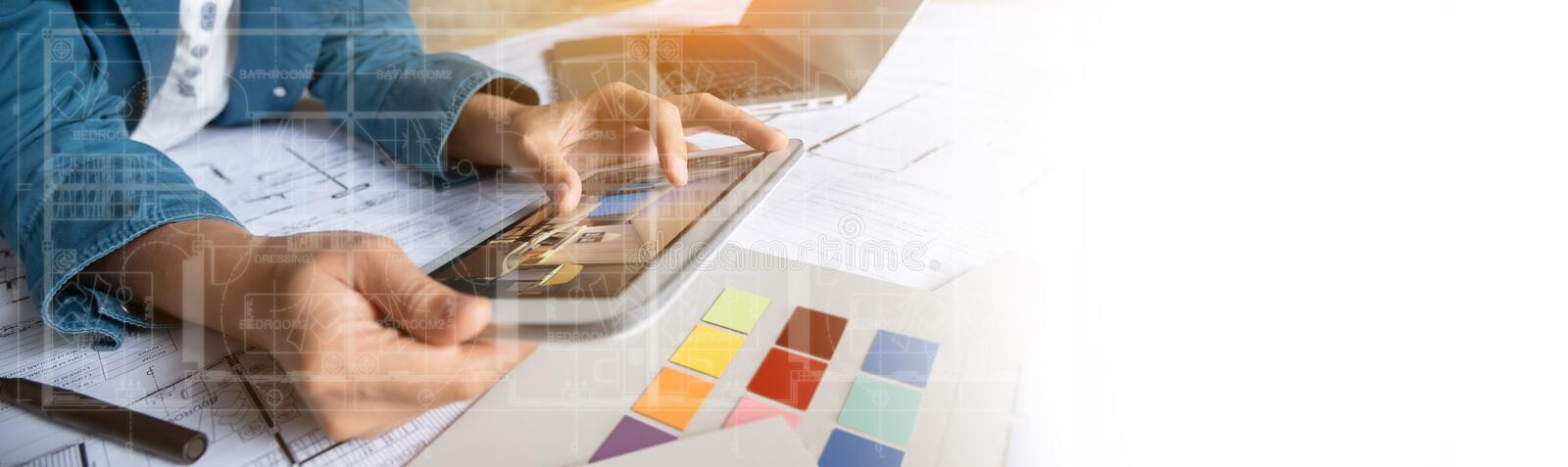 Architect working with digital tablet stock images