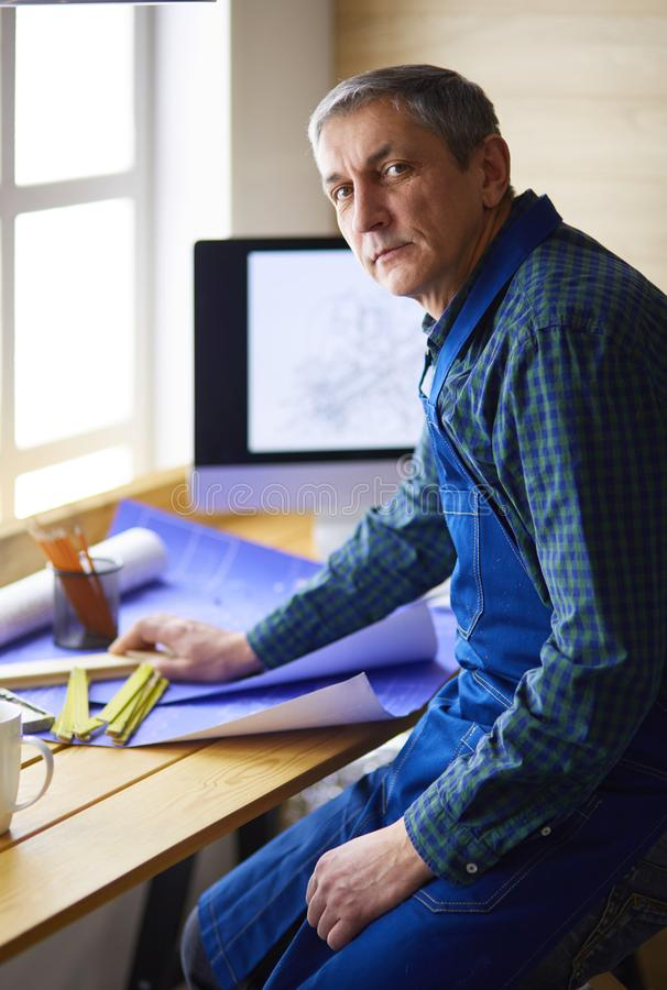 Architect working on drawing table in office royalty free stock photo