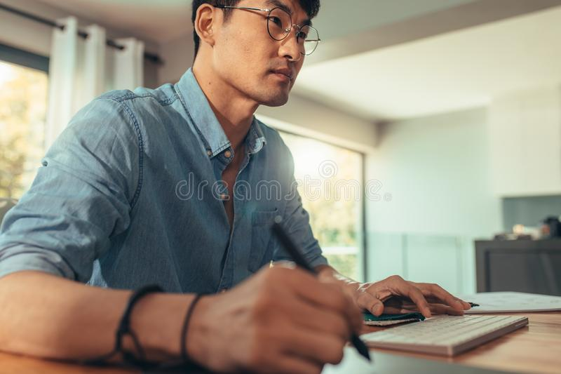Architect working at his desk stock photo