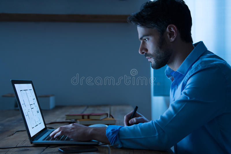 Architect working on laptop royalty free stock image