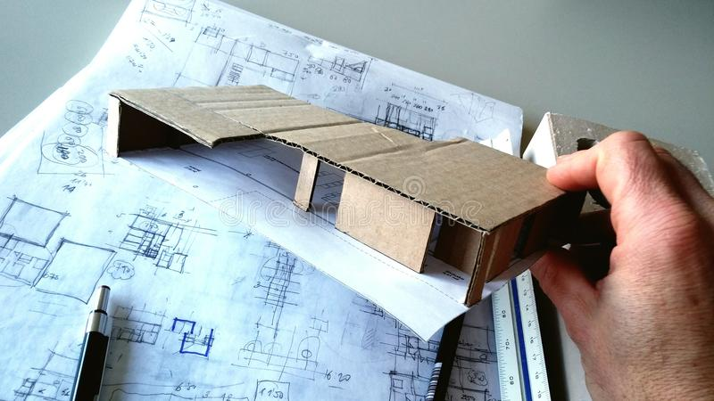 Architect working with models. And sketches stock images