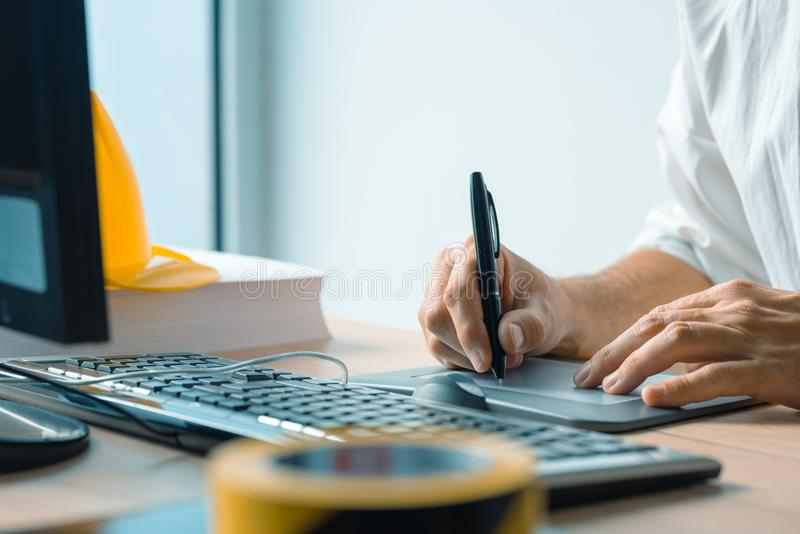 Architect working with sketch pen tablet and CAD software. In architecture project and design studio royalty free stock image