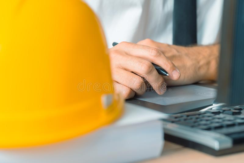 Architect working with sketch pen tablet and CAD software. In architecture project and design studio stock image
