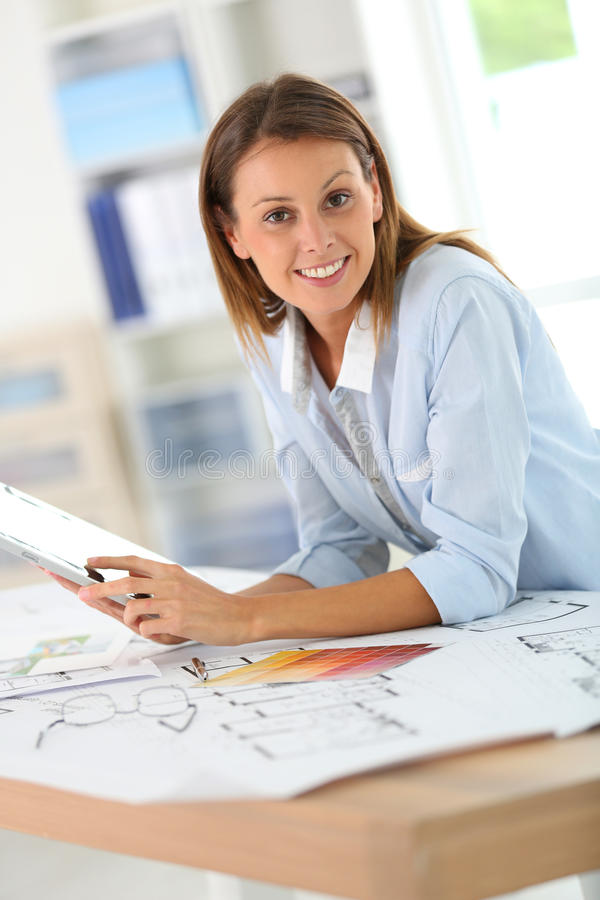 Architect working with tablet. Woman architect working in office on project royalty free stock photography