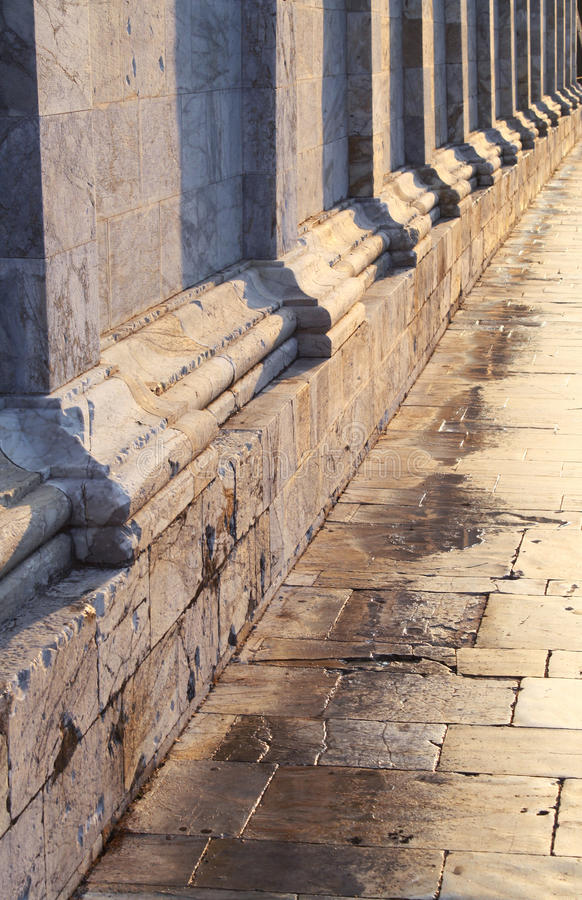 Architectonic detail. View of the wall with pillars and the pavement stock images