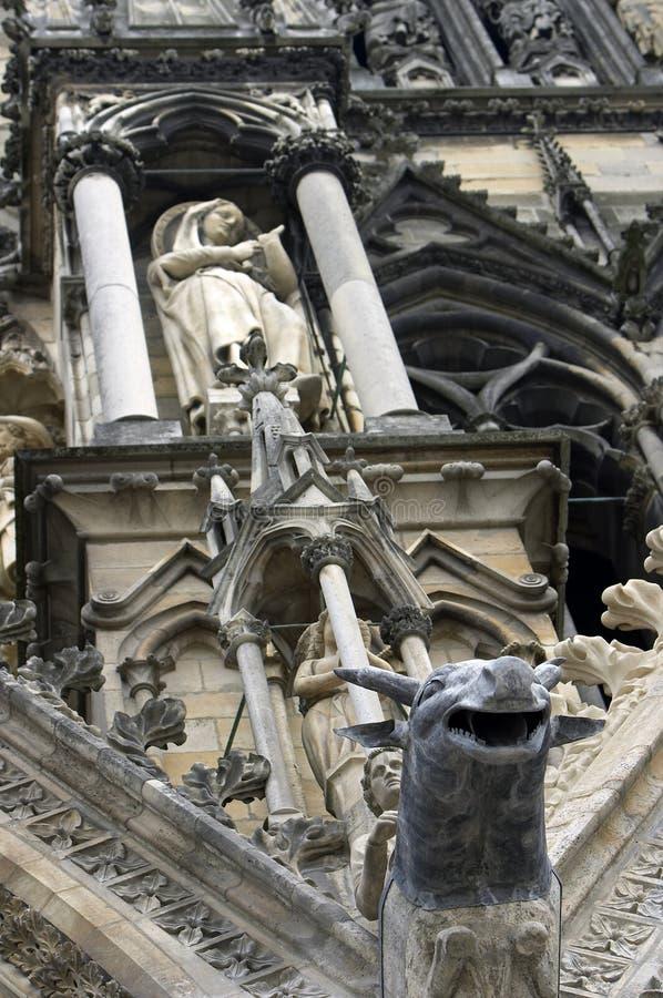 Architectonic detail. Gothic gargoyle, Rheims cathedral, detail of portal stock photos