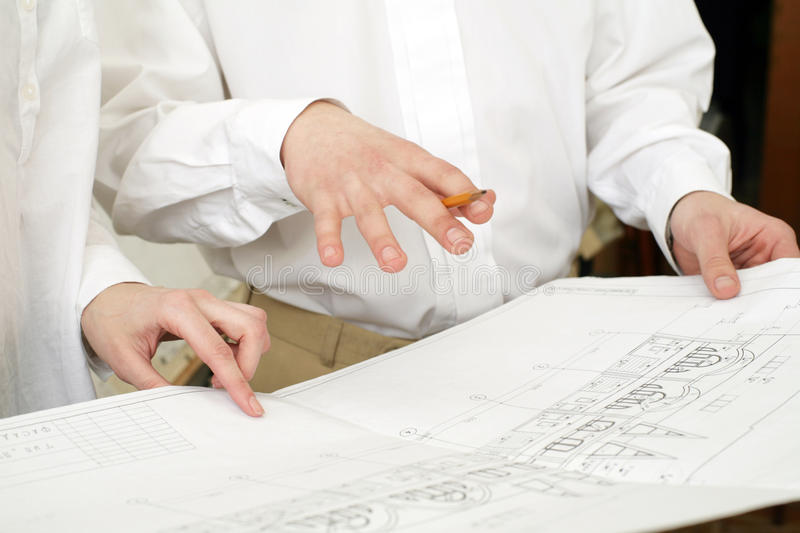 Architects. An image of two architects' hands doing work stock photos