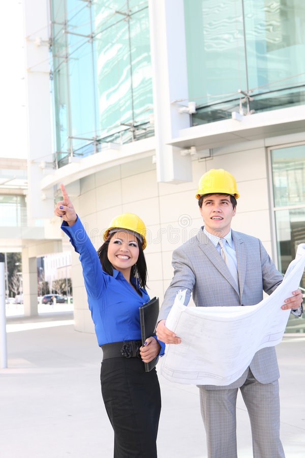Architects on Building Construction Site royalty free stock image