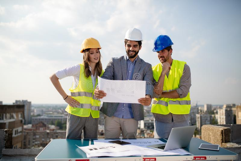 Architects, business manager and engineer meeting project at building site. Architects, business manager and engineer meeting project at construction site stock photography
