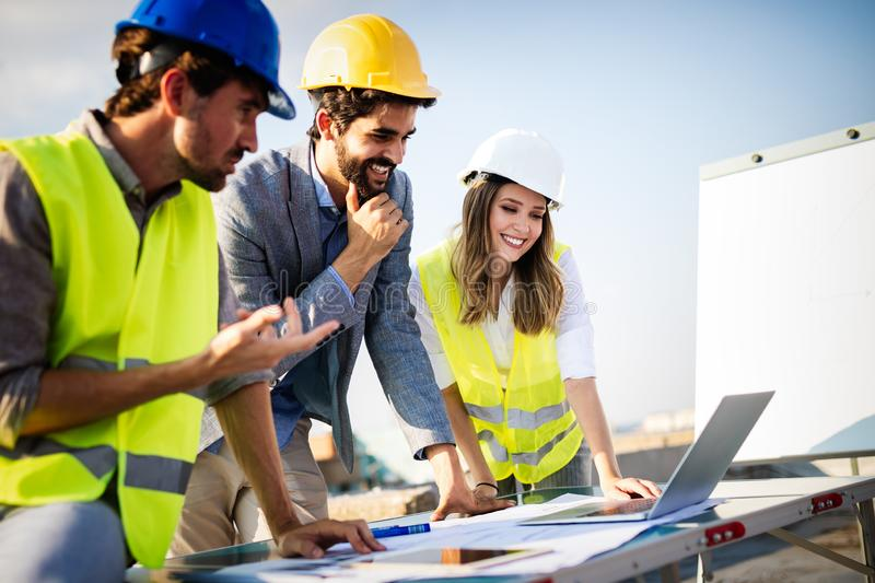 Architects, business manager and engineer meeting project at building site royalty free stock photography