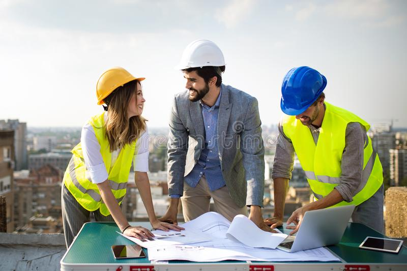 Architects, business manager and engineer meeting project at building site. Architects, business manager and engineer meeting project at construction site stock image