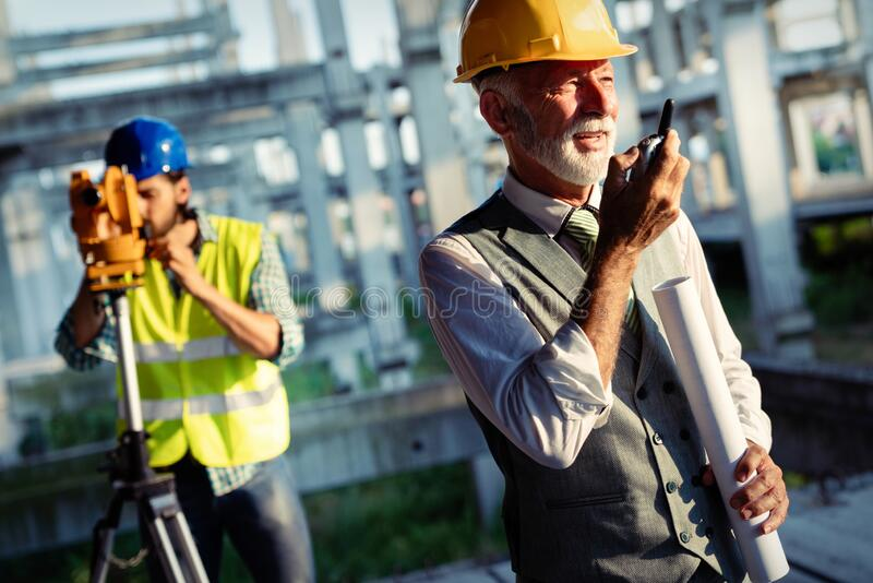 Architects, business manager and engineer meeting project at construction site royalty free stock photography
