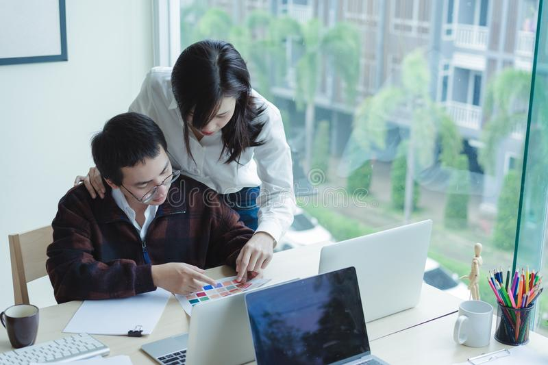 Architects choosing color samples for design project,creative graphic design. royalty free stock photography