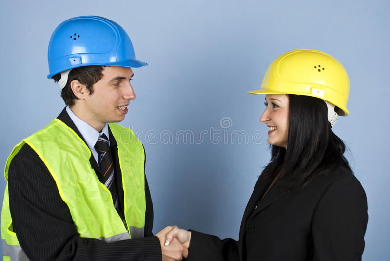 Architects conversation and shaking hands royalty free stock photos