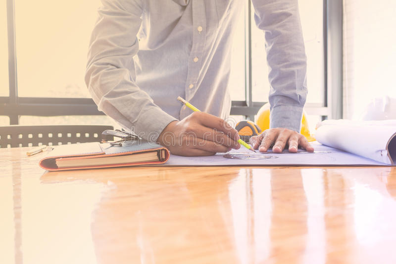 Architects create a project on a large painting. In the office stock image