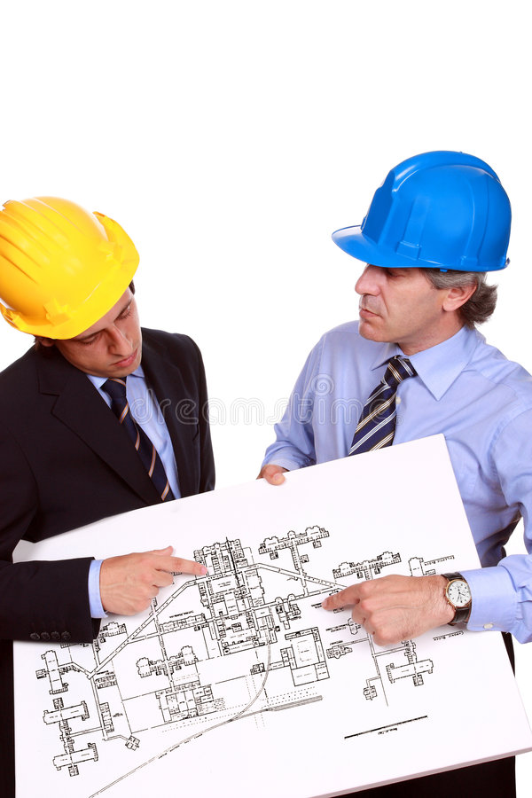 Architects debating. Architects with hardhats debating about a blueprint, isolated in white - studio shot royalty free stock image