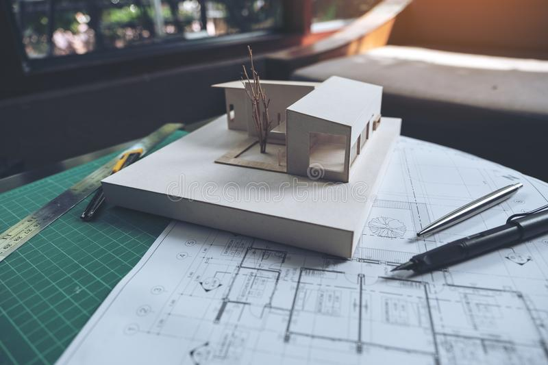 An architects designed mass model with shop drawing paper. On table stock photo