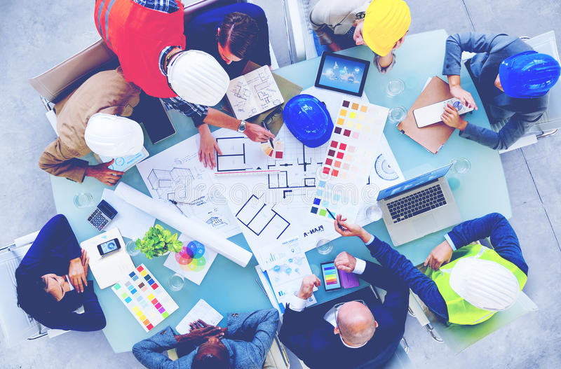 Architects and Designers Working in the Office Concept stock image