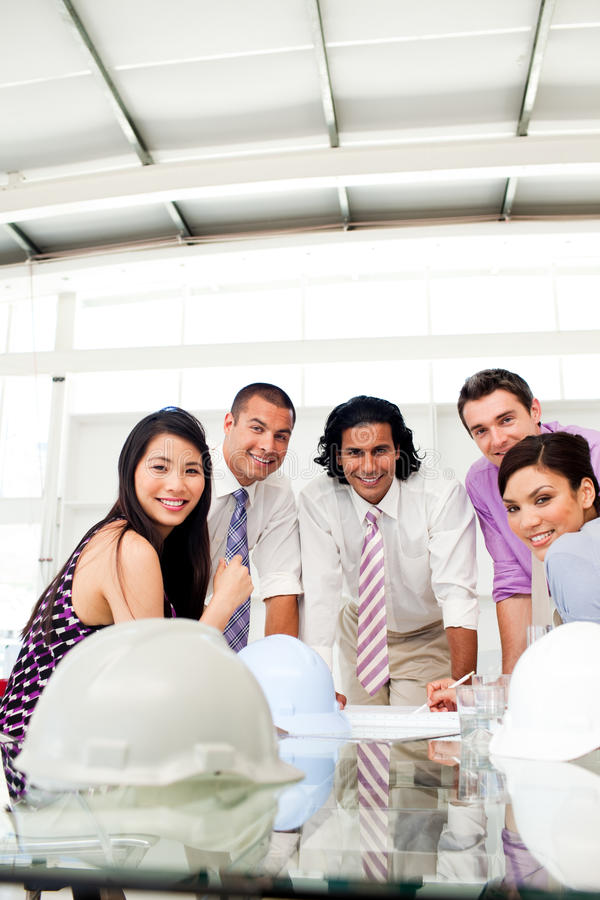 Download Architects Discussing A Construction Plan Stock Image - Image: 12041979