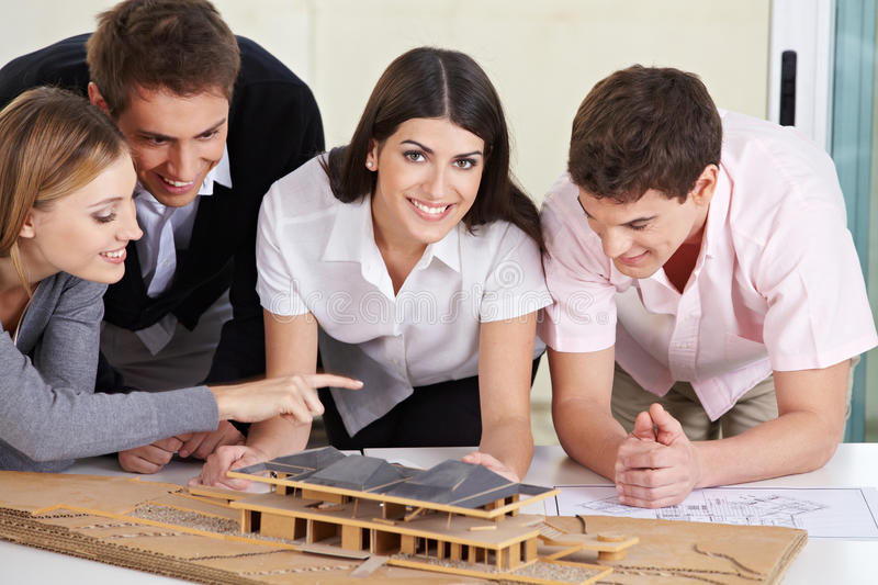 Architects discussing house draft stock photos