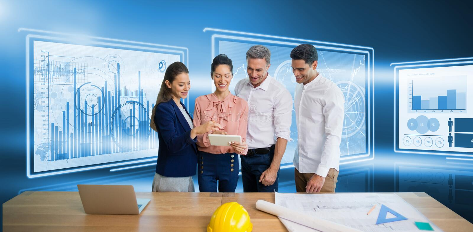 Composite image of architects discussing while standing by table royalty free stock image