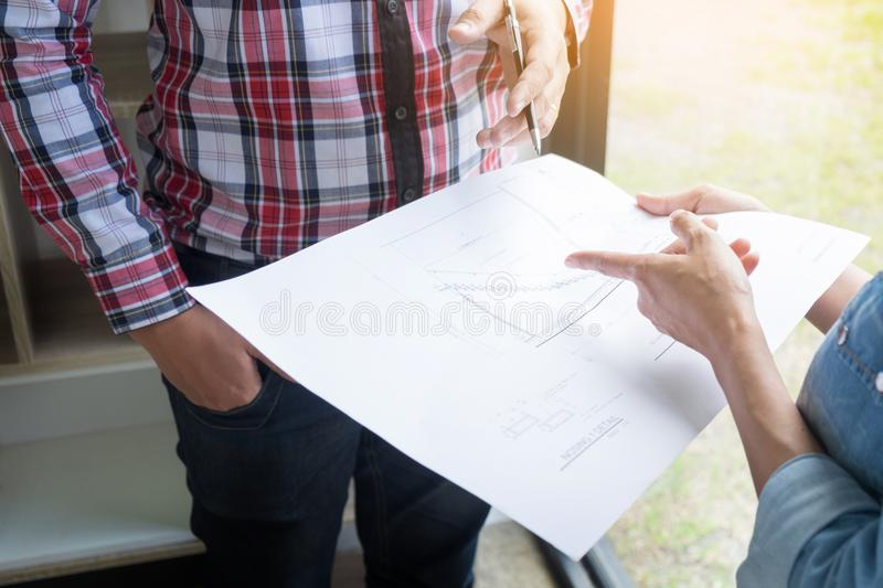 Architects engineer discussing at the table with blueprint clo download architects engineer discussing at the table with blueprint clo stock photo image of malvernweather Images