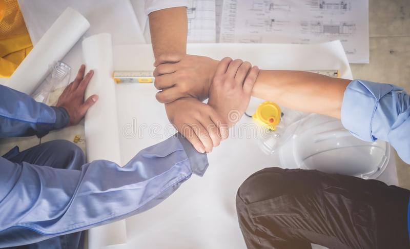 Architects, engineers and businessmen are joining hands for unit stock photography