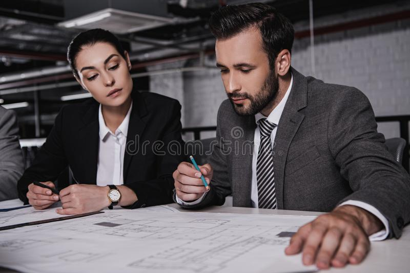 architects in formal wear working stock image