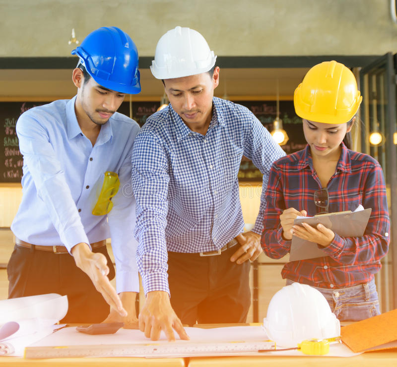 Architects Hands Working with Engineering on blueprint background stock photos