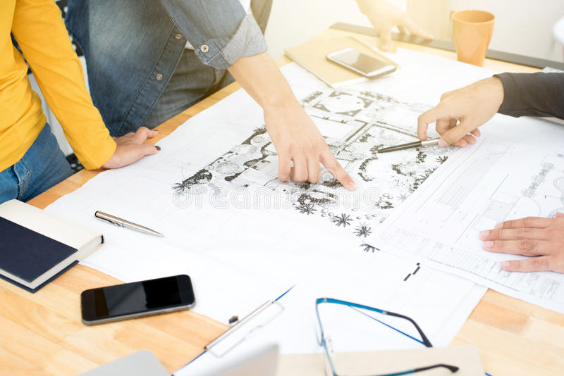 Architects or landscape designers discussing blueprints royalty free stock photo